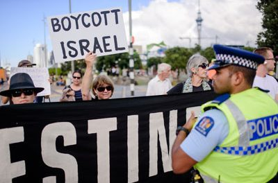 Police restrain protesters in Auckland